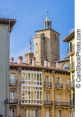 Church tower and apartment buildings in the center of...