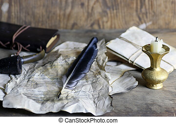 old paper letter feather