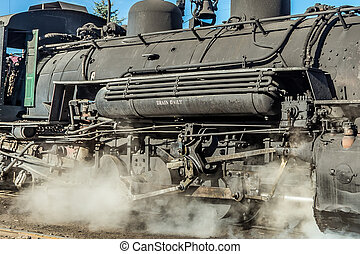 Steam locomotive - Detail of the boiler, wheels, and running...