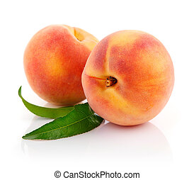 fresh peach fruits with green leaves isolated on white...