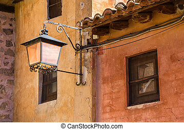 Street light on colorful houses in Albarracin