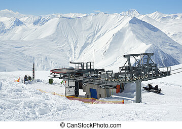 construction of ski lift mechanism in the mountains in...