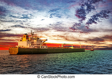 Tanker and tug - Tanker ship with escorting tugboat on sea...