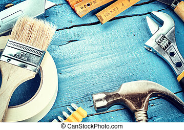 Set of various tools on blue wooden background. Renovation...