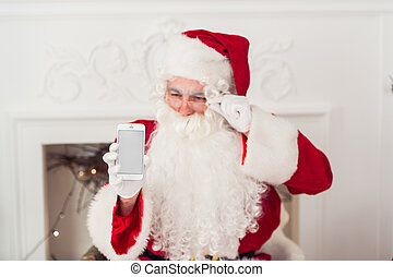 santa claus shows blank screen on a smart phone display.