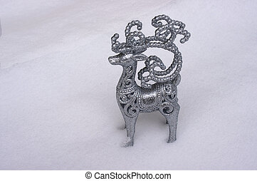 Figurine of Santa Claus reindeer Rudolph in snow