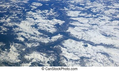 Snowy mountains and lakes from the aircraft
