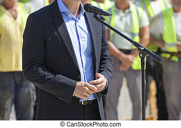 Politician or businessman is giving a speech - Public...
