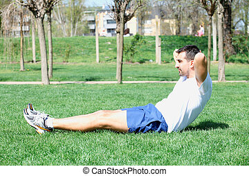 young sport man, fitness guy making push ups exercise.