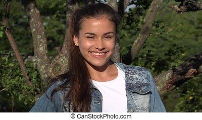 Hispanic Teen Girl In Park