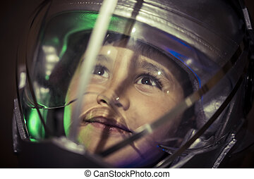 Science, Boy playing to be an astronaut with space helmet and metal suit