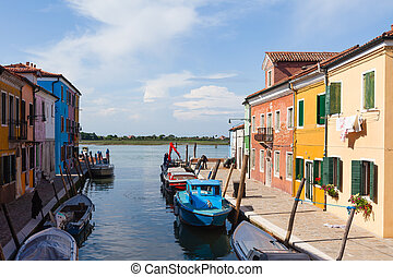 Colourfully painted houses on Burano, Venice, Italy. -...