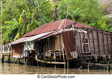 Thai old wooden house - Shanty house in Bangkok water canals...