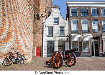 Historical cannon in front of a white house in Zwolle,...