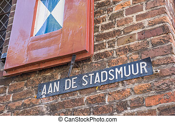 Street sign on the medieval city wall of Zwolle, Holland
