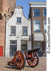 Historical cannon in front of a white house in Zwolle