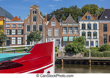 Bow of a red ship and historical houses in Zwolle,...