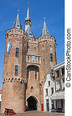 Old city gate Sassenpoort and cannon in Zwolle, Netherlands