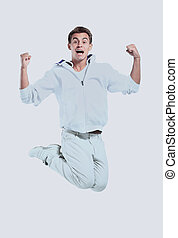 Jumping young man. Isolated over white background