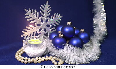New Year's balls and ribbon on a blue background