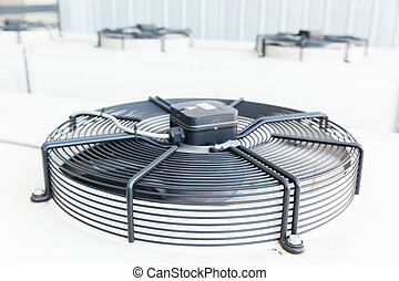 Cooling industrial air conditioning units closeup. Fans on...