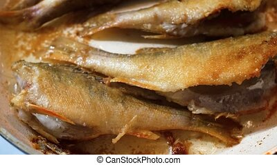 Fish fried in hot oil in a frying pan - Fish frying in hot...
