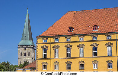 Castle and the tower of St. Katharinen church in Osnabruck,...