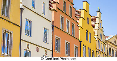 Panorama of colorful houses at the market square in...