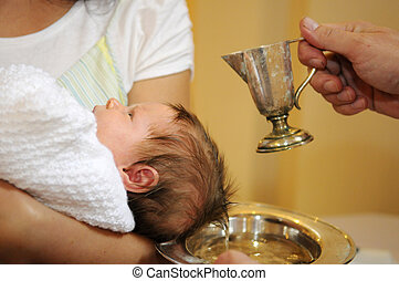 The baptism of little baby with blessed water from iron jug