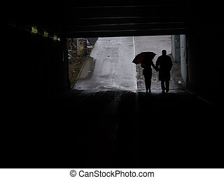 silhouettes people pedestrian underpass