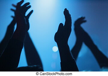 hand clapping at a concert