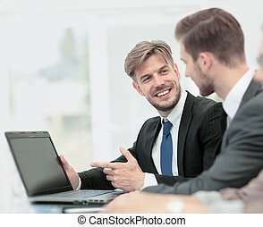 Business people working on laptop in an office - Successful...