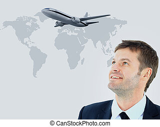 businessman smileeng and looking at airplane