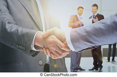 Closeup of a business handshake in office