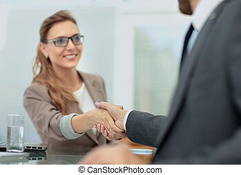 Business woman shaking hand to her partner - Happy business...