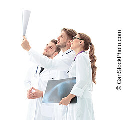 A group of doctors examining an x-ray in the hospital -...