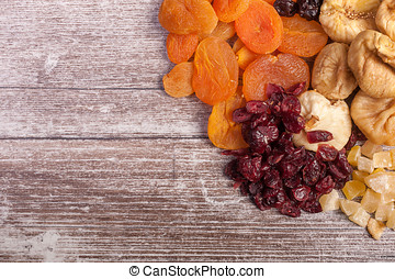 Different type of dried fruits on wooden table - Different...