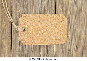 Old fashion gift tag, A retro cork gift tag on weathered...