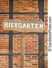 Beer garden sign in front of a half-timbered wall - Beer...