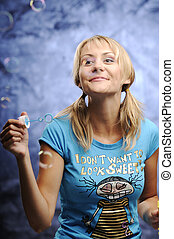 Woman with bubble gum - The beautiful young blonde woman...