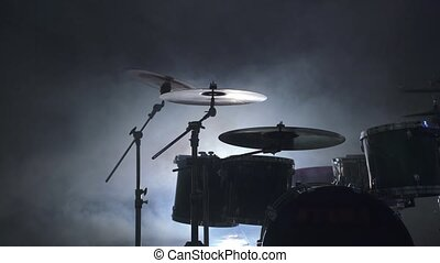 View of modern drum kit in smoky studio - View of modern...
