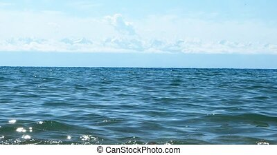 Surf on Lake Issyk-Kul in the background of mountains, beach...
