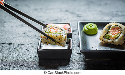Delicious California Maki sushi with wasabi and soy sauce -...