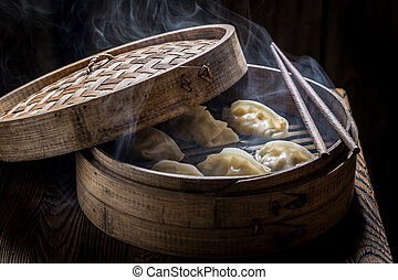 Boiled and hot chinese dumplings in bamboo steamer