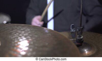 View of drummer plays on his drum kit, close-up