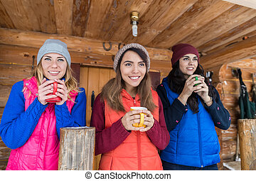 Young Girl Group On Terrace Holding Cup Hot Coffee Tea...