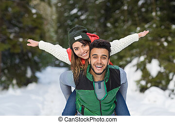 Young Mix Race Couple Snow Forest Outdoor Winter Walk Pine...