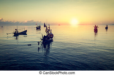 Fishing boats floating on the sea