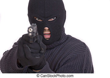 thief with gun aiming into a camera - isolated on white...