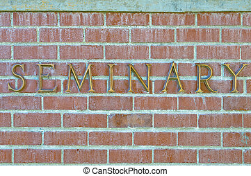 Seminary sign on brick wall